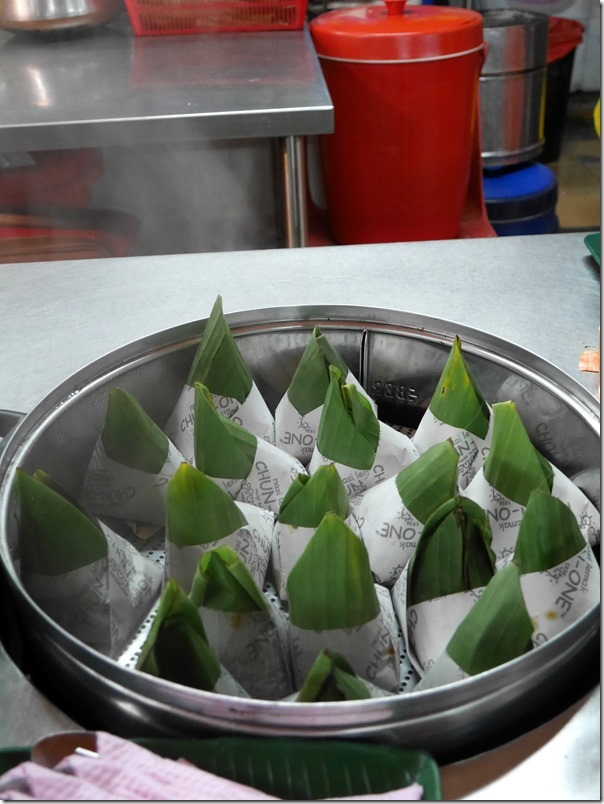 Nasi lemak bungkus kept warm in steamer