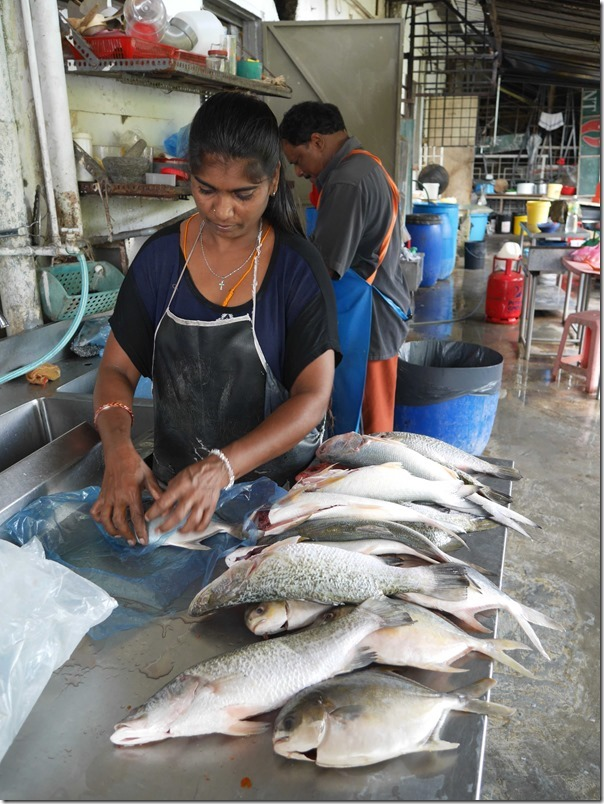 Cleaning fish at Kam Kee Seafood Restaurant