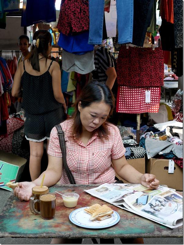Catching up on the news over coffee and toast, Jalan Imbi Market, Kuala Lumpur