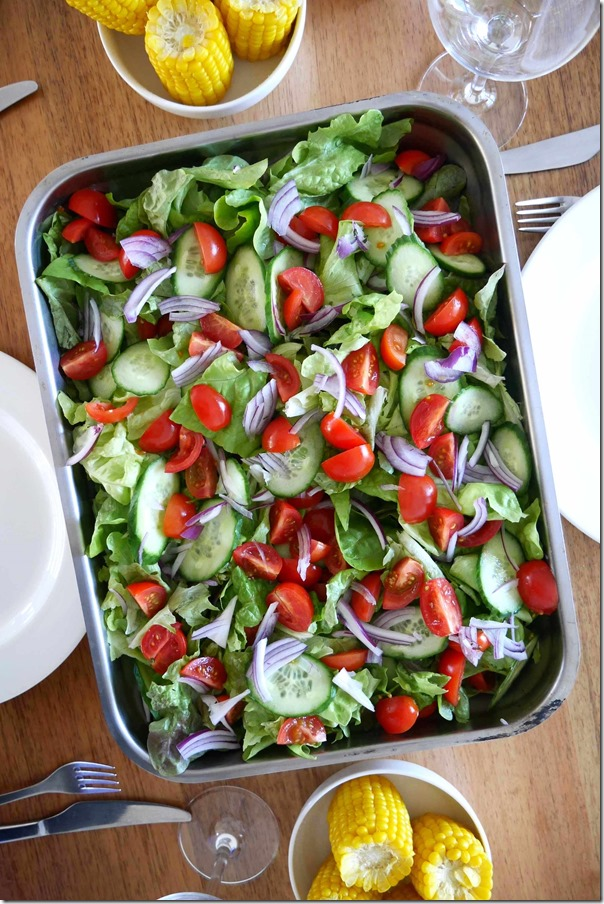 Salad of cherry tomatoes, butter lettuce, onions and cucumber