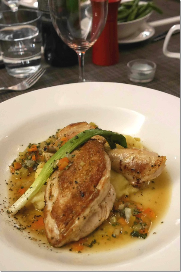 Seared breast and confit leg of chicken with creamed potato, chicken and vegetable broth and glazed young  leeks $31