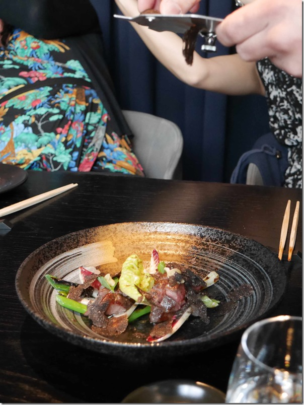 Chef Kojima shaving black truffle onto Wagyu oyster blade teppanyaki style
