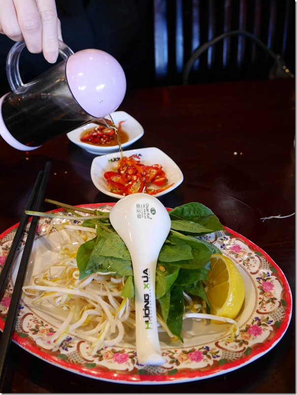 Light soy onto fresh chilli, fresh beansprouts, mint and lemon at Pho Huong Xua, Canley Heights