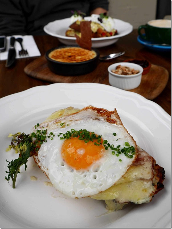 Croque Madame ~ Classic toasted bacon & cheese topped with cheese bechamel & fried egg $15.50