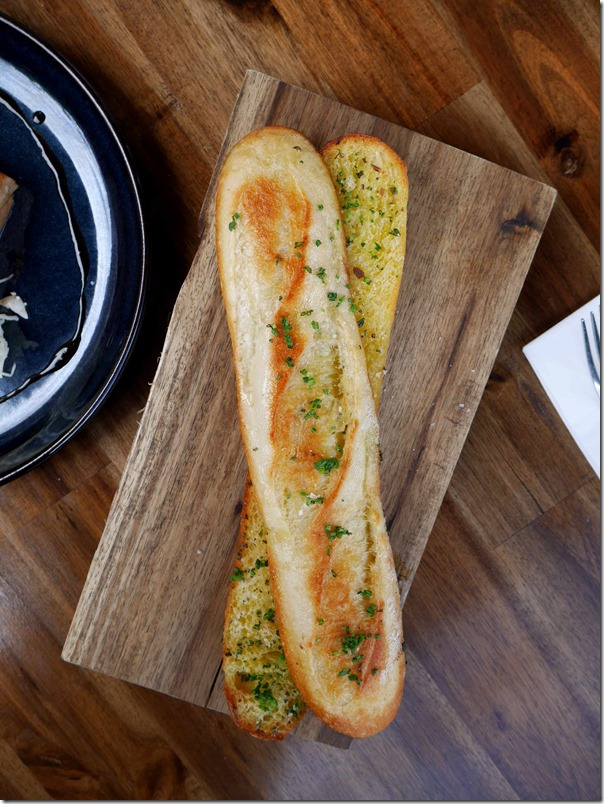 Roasted garlic & mixed herb baguette $7