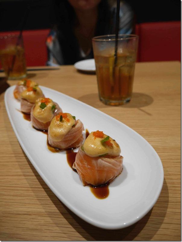 Seared salmon sushi $13
