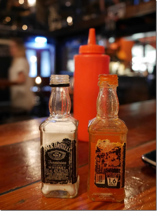 Salt & hot sauce in used Jack Daniel's Whiskey bottles