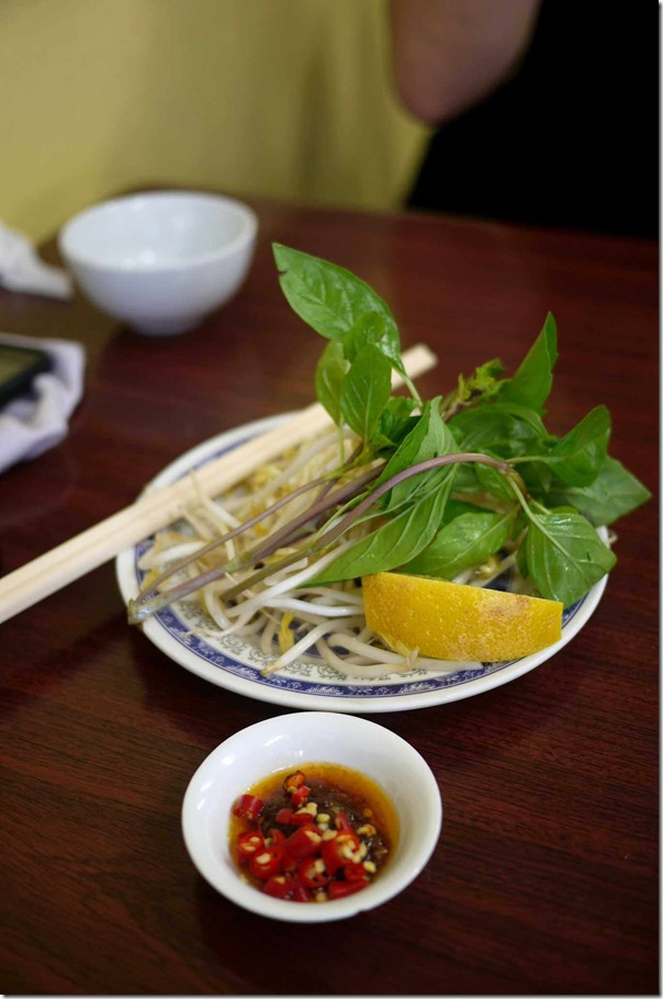 Fresh chilli, blanched beansprouts, mint leaves and lemon at Old Thanh Huong