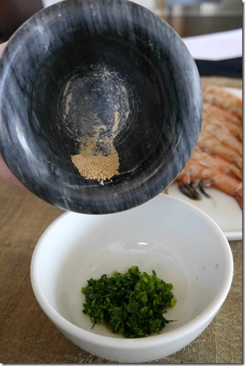 Adding bonito seasoning to finely diced coriander