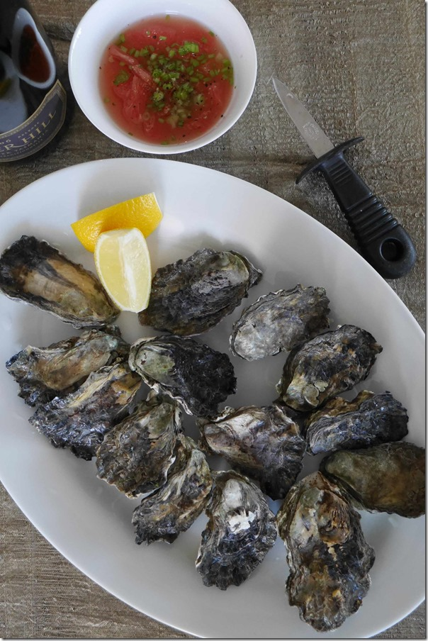 Unshucked Pacific oysters with ruby grapefruit vinaigrette