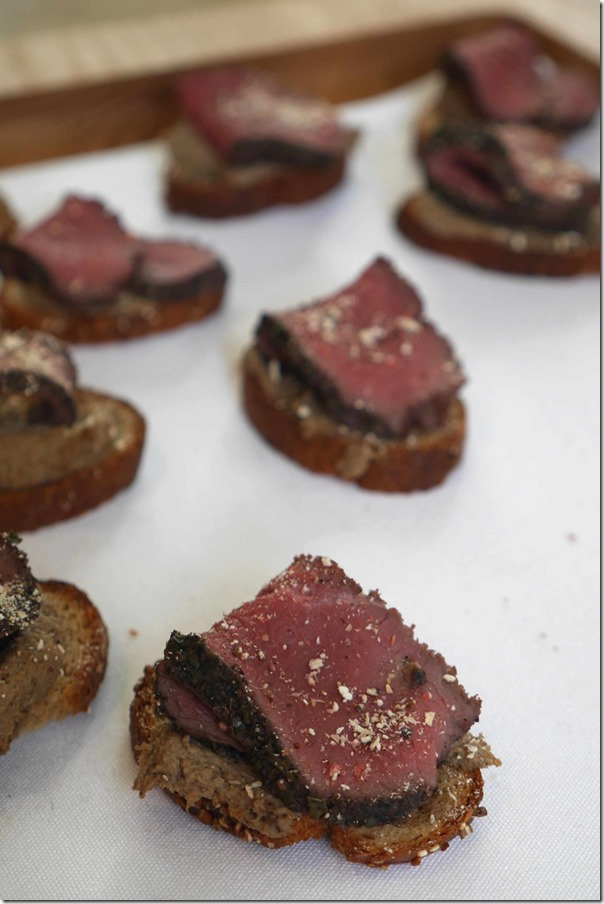 Smoked venison & mushroom pate on rye croutons dusted with ras el hanout