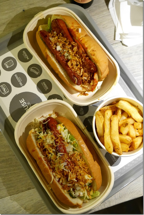 Top: K-Dog $9.50, The Spicy Dog $9.50 and House made chips $4.90