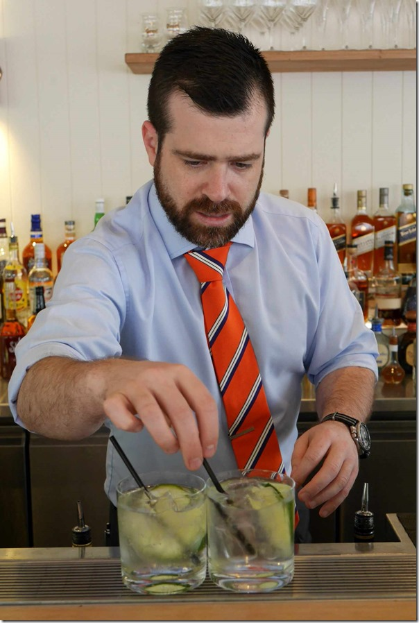 General Manager Mikee Collins making G & Ts