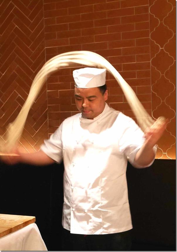 Noodle Master Pei Lin Jai demonstrating hand-made noodles
