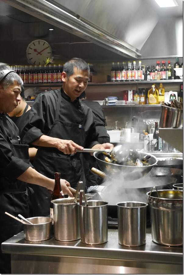 Chefs stir-frying mussels, Billy Kwong, Potts Point
