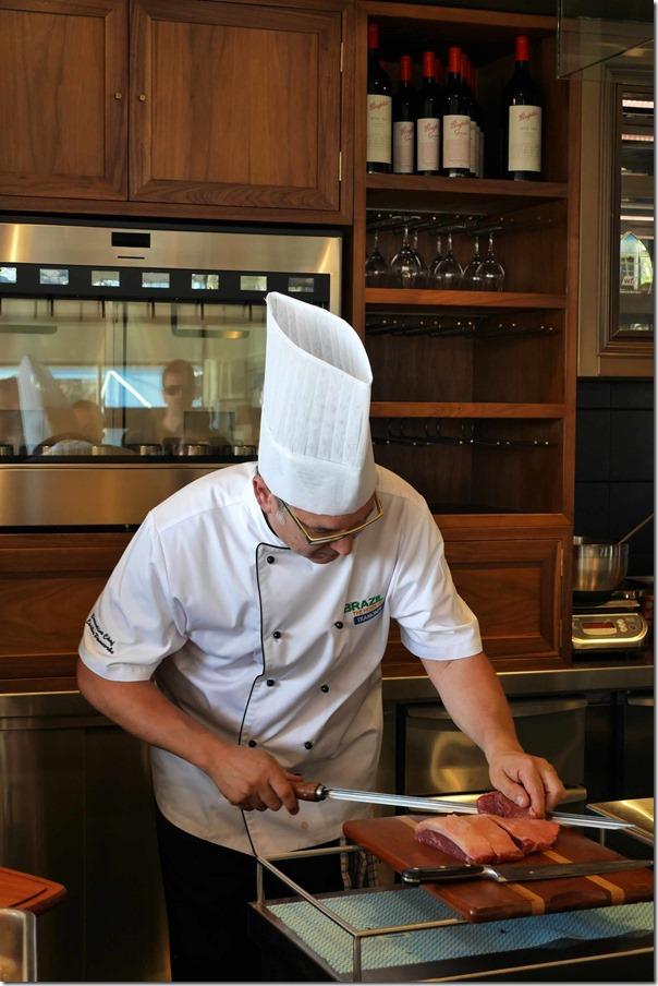 Chef Carlos Pancorbo skewering wagyu rump cap