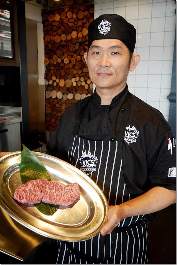 Teppanyaki chef Eric Chan with a piece of AACo Wagyu Sirloin BMS11+ 250g, $85