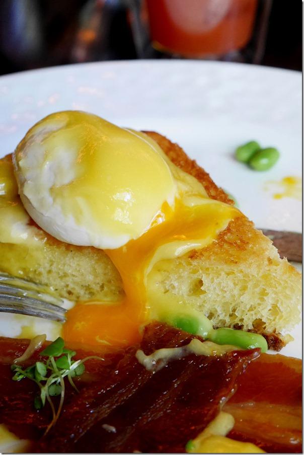 Eggs Benedict, on brioche, streak bacon, edamame and miso hollandaise