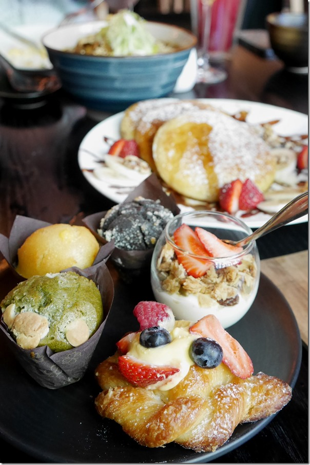 Breakfast muffins, pastries, cereal and yoghurt