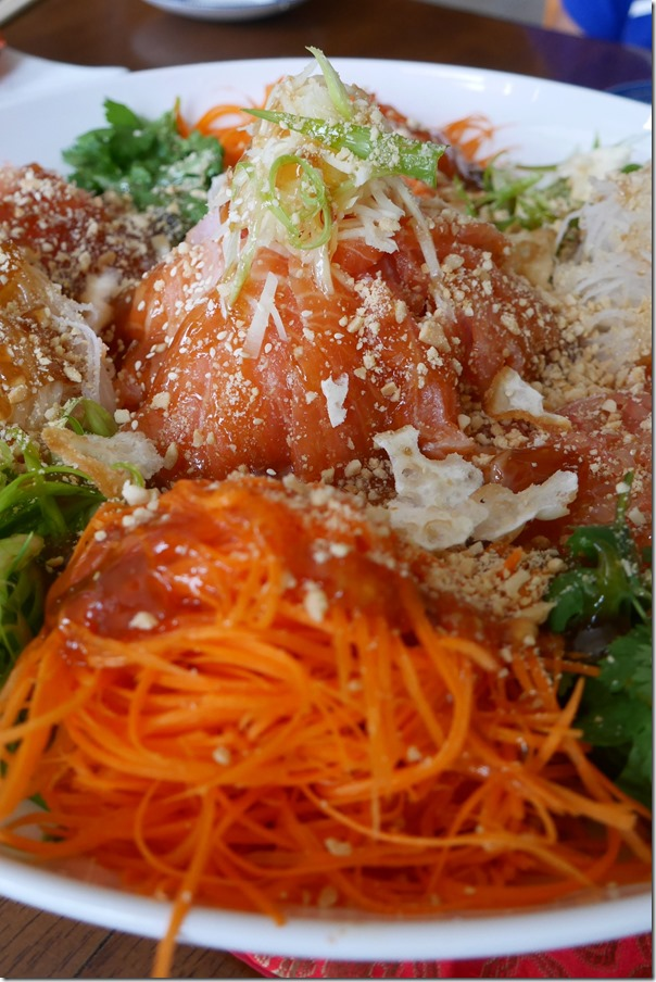 Mysaucepan's yee sang sprinkled with sashimi salmon, sesame seed and peanuts