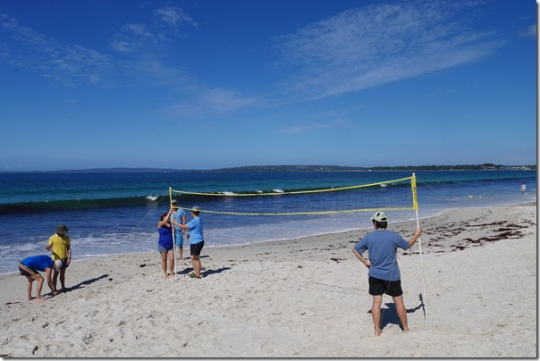 Setting up the net for beach volleyball