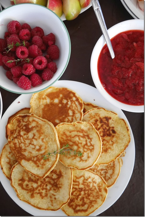 Raspberries, strawberry compote and pancakes