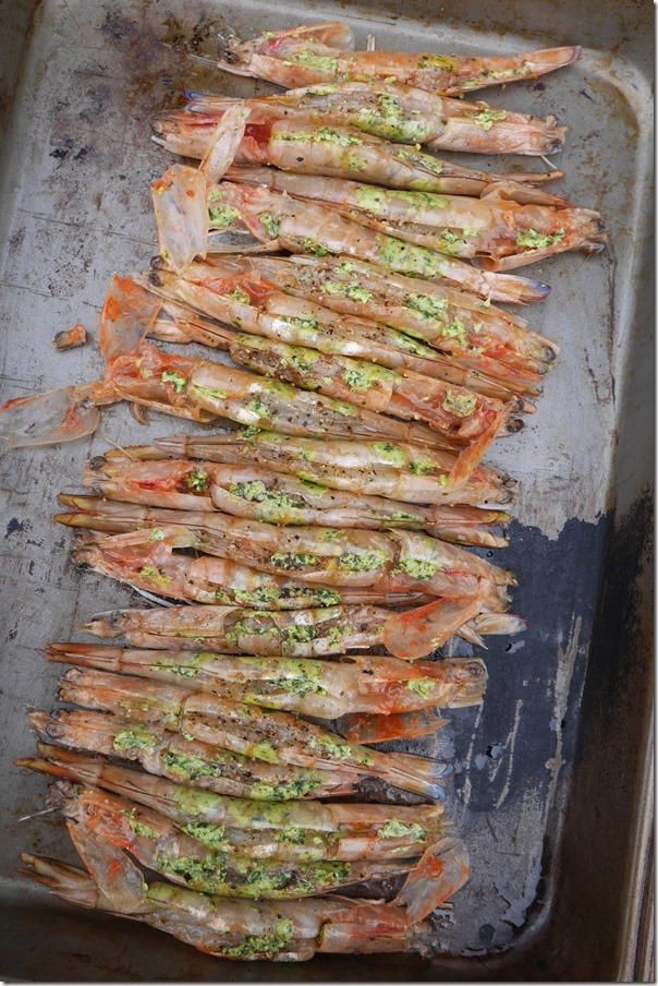 Green prawns stuffed with herb butter