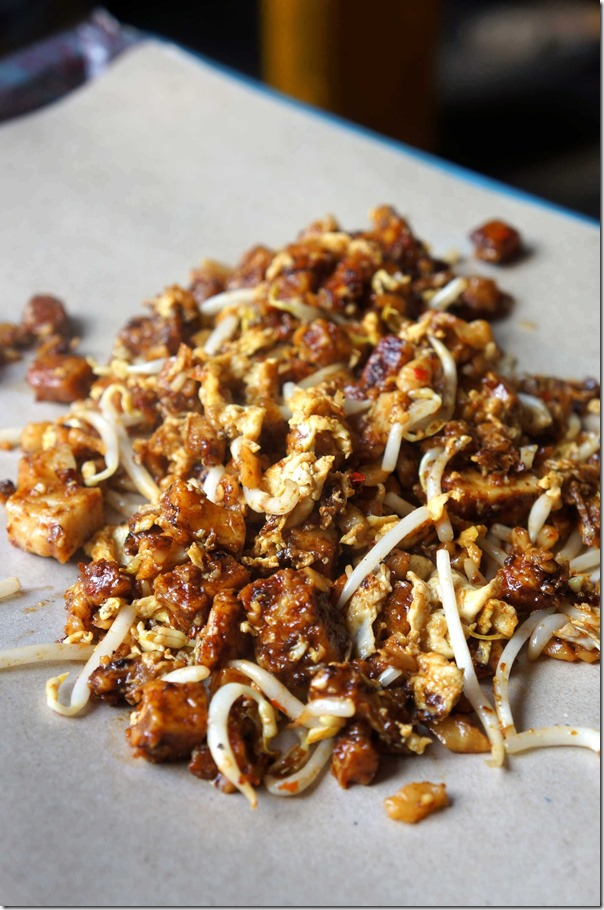 Chai tow kway ~ stir fried radish cake with chilli, dark caramel sauce and egg
