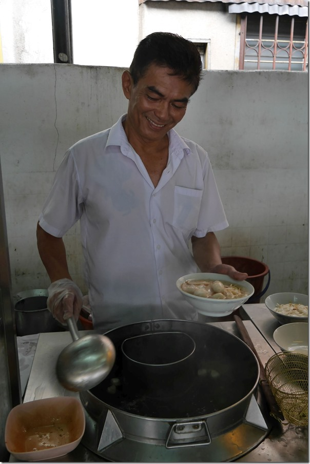 The proprietor Ah Choy preparing a bowl of fish ball noodles