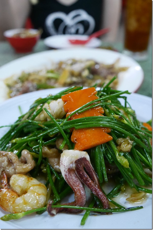Stir-fried garlic chives with seafood RM40 / A$14