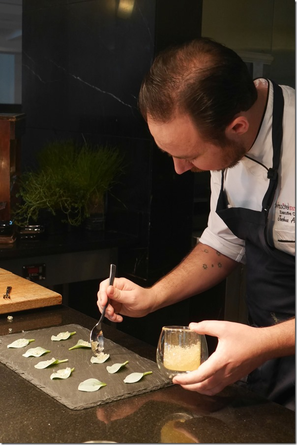 Executive Chef Joshua Askew preparing oyster leaf topped with lemon myrtle caviar