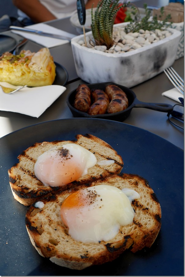 Free range slow poached eggs on Loafers organic toast $12, side of bacon and pork chipolatas $6