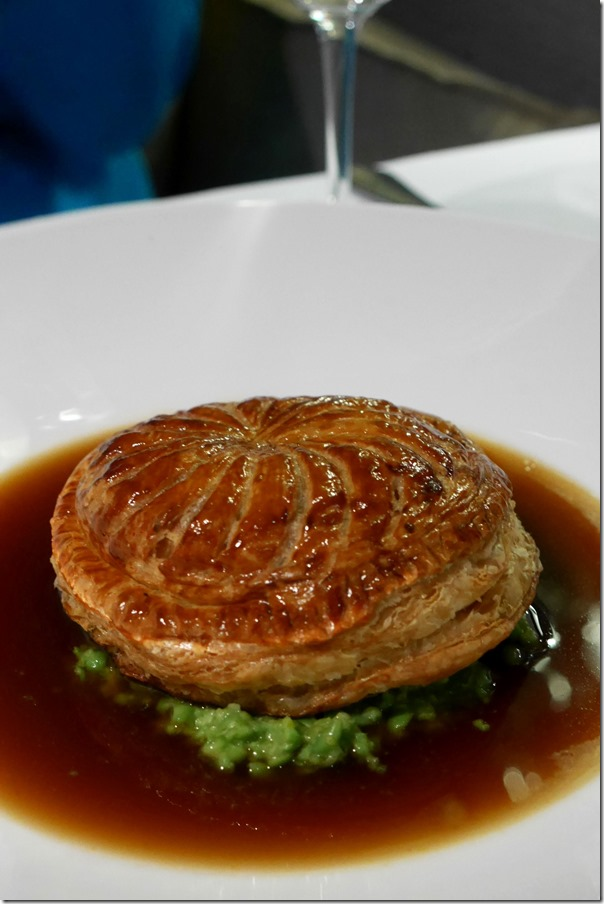 Pithivier with mushy peas and jus $34
