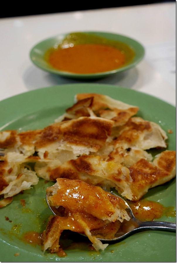 Roti prata with fish curry sauce