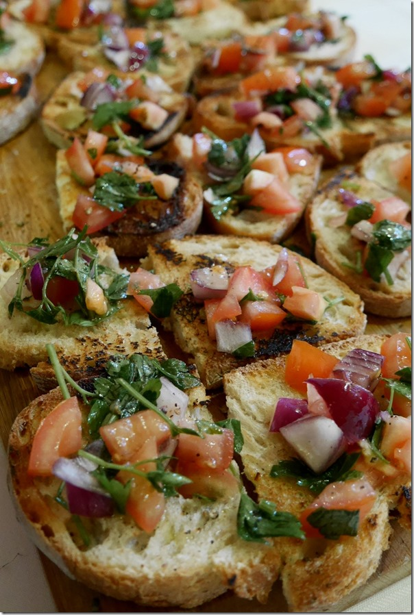 Bruschetta with diced tomatoes, onions, basil, EVOO