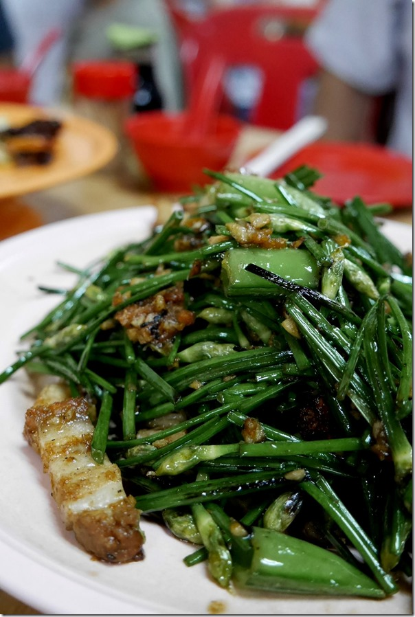Stir-fried garlic chives with roast pork RM25 / A$7.60