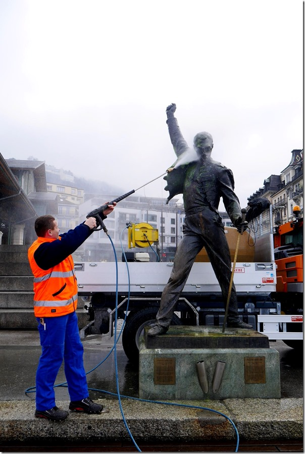 Local authority staff removing paint from Freddy Mercury statue