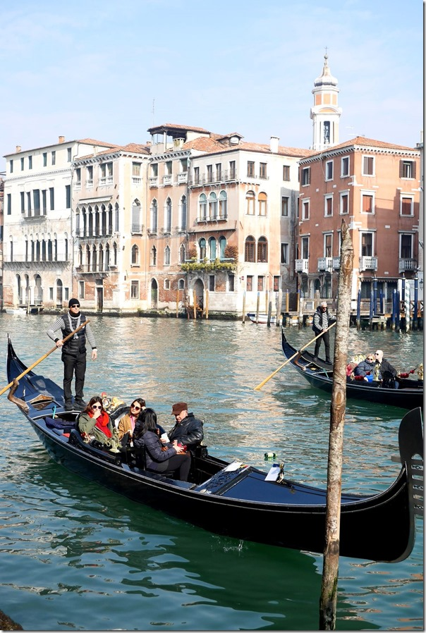 Tourists on a gondola in the Grand Canal