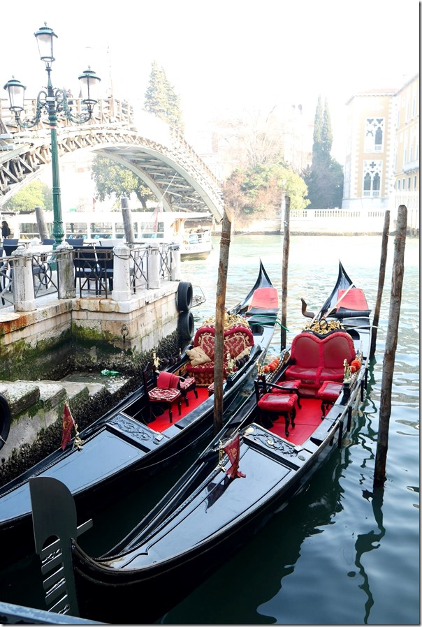 Gondolas docked along a canal in Venice