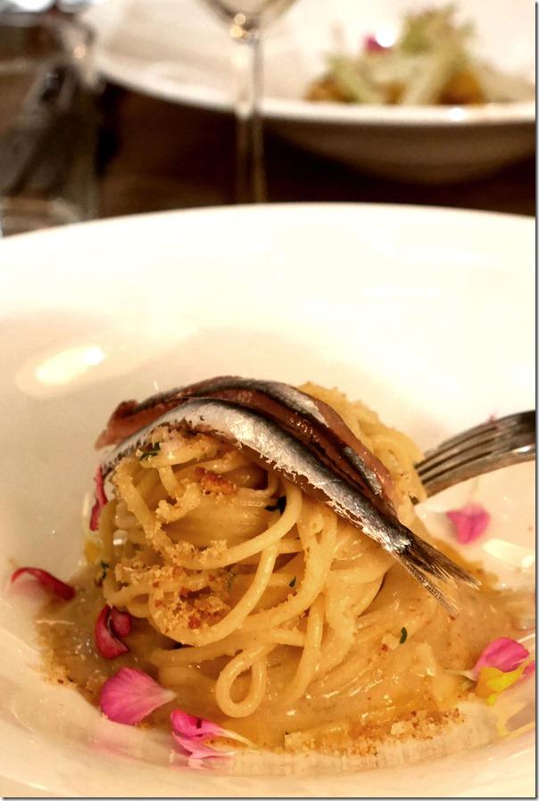 Spaghetto, alici, agrumi e pane croccante €16 / A$22.40