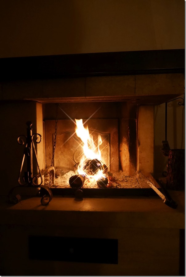 The fireplace is warm and toasty