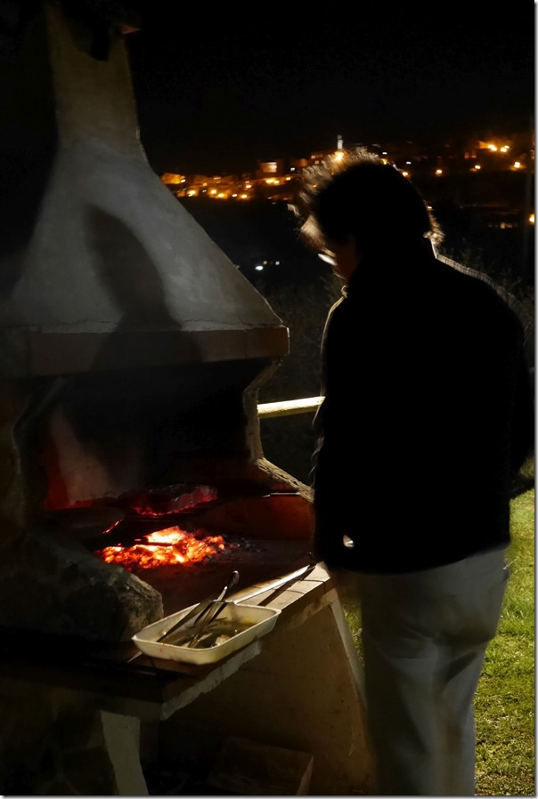 Watching the bistecca sizzle away in the cool wintry night