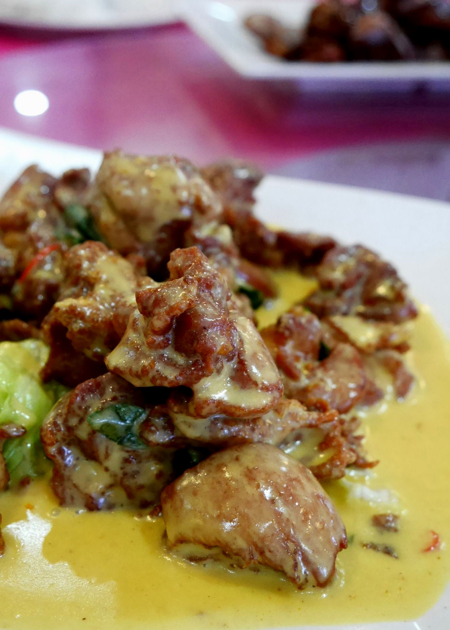 Deep-friend chicken in coconut and turmeric sauce